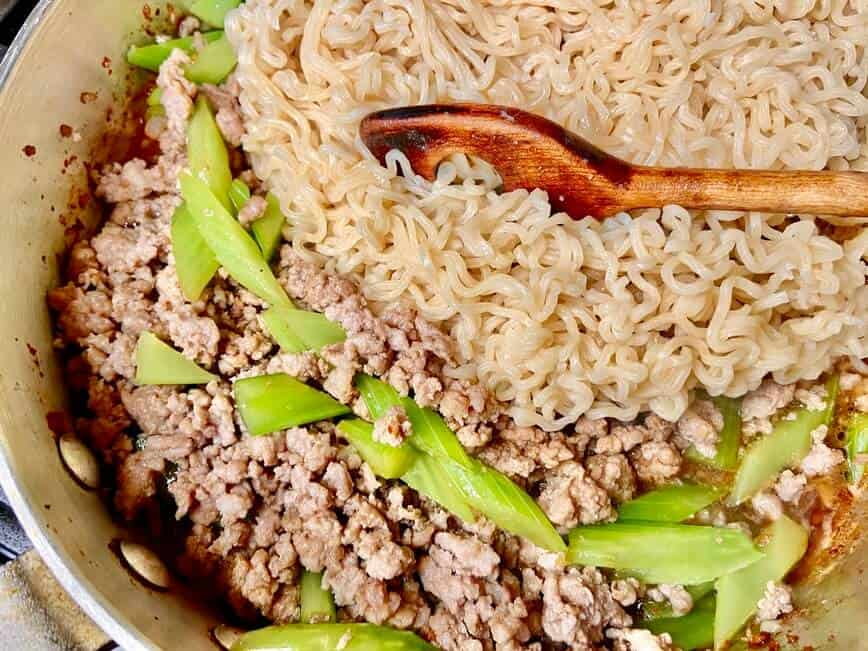 Ground Pork Ramen - adding cooked noodles to the pan (Photo by Erich Boenzli)